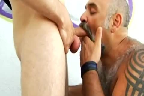 lad banging a hairy bulky bear