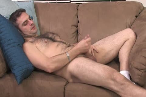 bushy dude Lays On The bed And Starts Playing With His Hard Pole